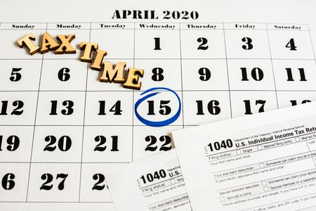 Day 15 marked on the calendar as a reminder to pay taxes. Stock Photo