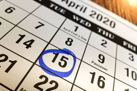Day 15 marked on the calendar as a reminder to pay taxes. Stock Photo - 128718111
