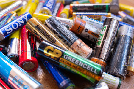 Valencia, Spain- July 24, 2019: Pile of old and used AA and AAA batteries, damaged and broken by acid, ready to send a clean recycling point. 報道画像