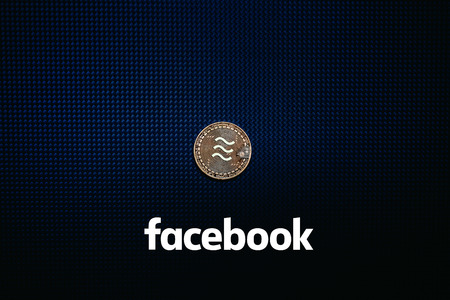 Valencia, Spain - June 18, 2019: Facebook launches new digital currency, Libra, along with virtual wallet application Calibra, to revolutionize online shopping safely. 報道画像