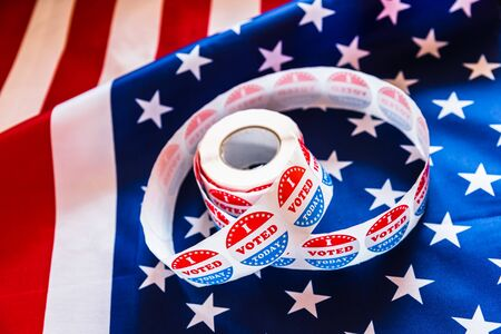 Stickers for voter supporters who have fulfilled their duty to cast their vote in the American elections, background with flag.