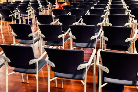 Row of empty chairs in a university class.