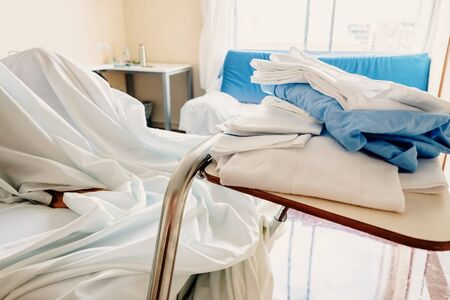 Dirty blankets on a patients bed in a hospital.