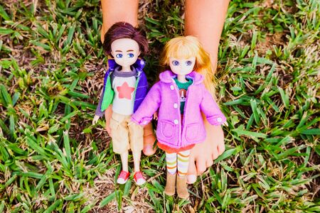 Girl playing with dolls without gender bias or negative stereotypes. Imagens
