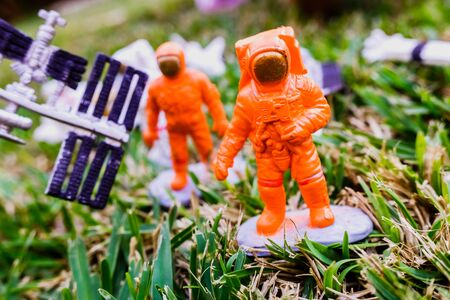 Detail of some plastic astronaut dolls.