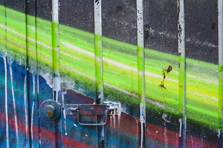 Detail of an anonymous street graffiti with many colors, cheerful urban background. Standard-Bild - 133024699
