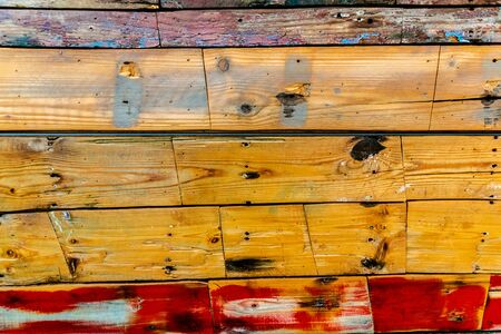 Painted wooden boards of various colors aged, natural texture background.