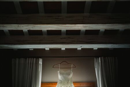 Wedding dress hanging on top of the roof. Zdjęcie Seryjne