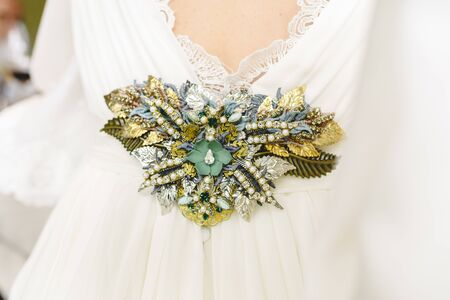 Flower shaped brooch made with small gemstones for a wedding dress. Archivio Fotografico