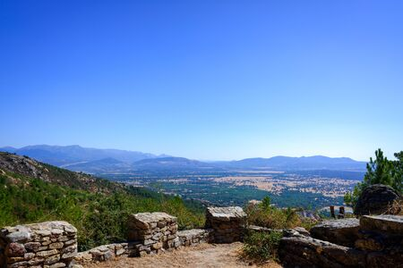 View from a medieval fortress of the Guadarrama valley in Madrid with its mountains in the background.