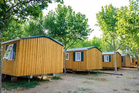Bungalows, portable wooden houses, in a summer holiday resort. Reklamní fotografie