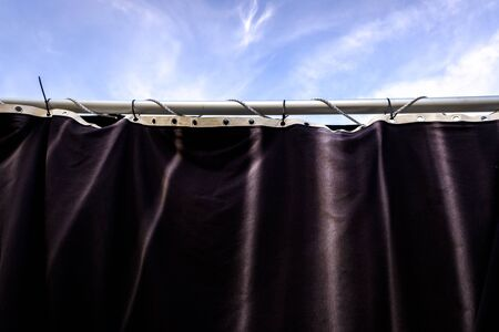 Stage with black curtain for a theatrical function.