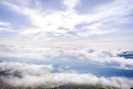 Scene of a winter cloudy sky from the top of a mountain peak. Imagens