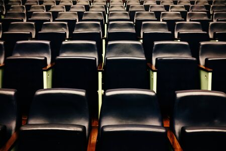 Rows of empty seats and seats in an auditorium.