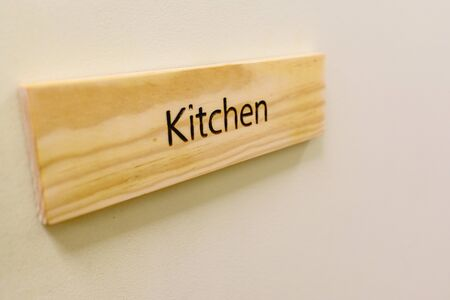 Wooden sign with the word Kitchen.