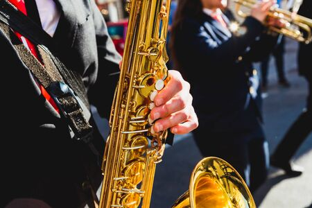 Saxophonist fingers playing a piece during a street festival. Zdjęcie Seryjne