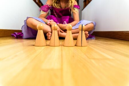 Girl ordering pieces of wood, an educational toy to learn the shapes and fractions. Zdjęcie Seryjne