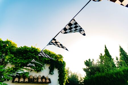 Hanging decoration pennants with the design of a checkered flag. Imagens