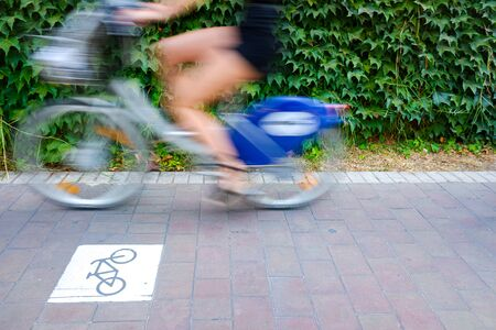 Motion blurred cyclists to show speed, driving along a bike lane, and make transport and urban displacements more sustainable.