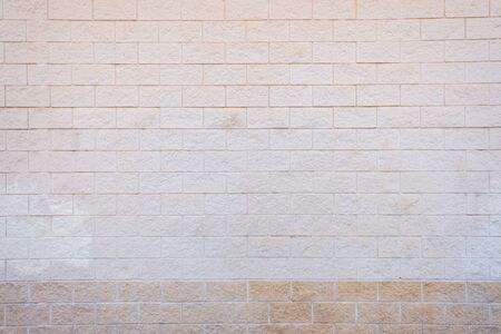 White brick wall with a rough texture.