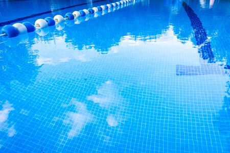 Detail of the water of a pool with beacons to separate the swimming streets.