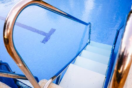 Security ladder in a pool for people with low mobility. Imagens