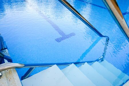 Stairs to enter and exit a pool.