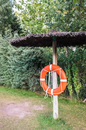 Life buoy near a pool in case of emergency. Imagens