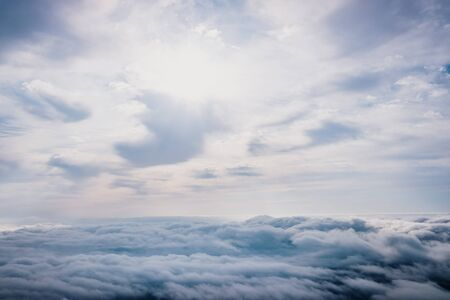 Awesome view on top of the clouds on a cloudy morning.