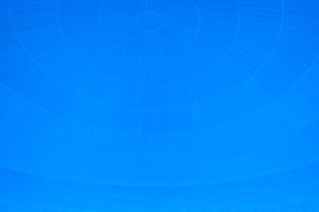 Blue background with spherical circular patterns.