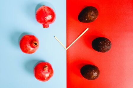 Colorful background composition with healthy fruits and clock-shaped sticks