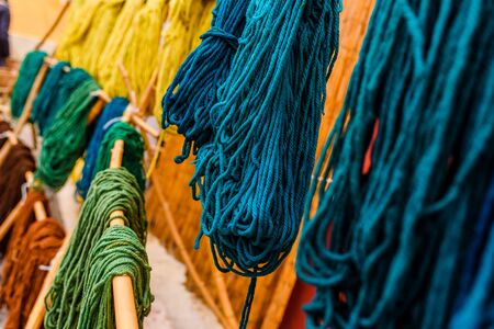 Yarns of colored wool freshly dyed by Arab craftsmen drying in the sun. Reklamní fotografie
