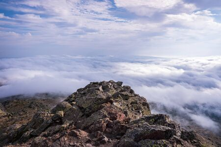 Peñalara Peak, in the Sierra de Guadarrama, seen from the cliff of birds and carnations, a day of clouds. 写真素材
