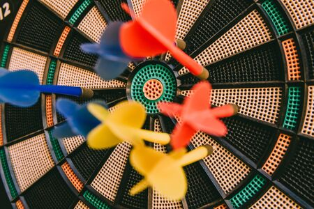 Center of a bullseye with colorful darts nailed, target concept. Stok Fotoğraf