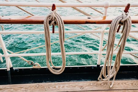 Boat mooring ropes wound on a sailboat. Stok Fotoğraf