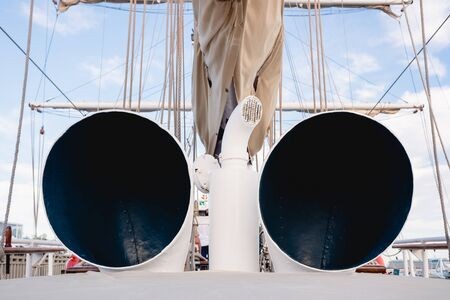 Two cowl vents of a sailboat.