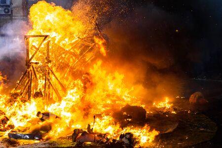 Detail of a Falla Valenciana burning between flames of fire. Stock fotó