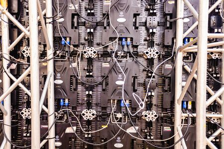 Valencia, Spain - November 17, 2019: Led panel of a giant screen seen from behind, of the Alfalite brand, with dozens of complicated electronic connections.