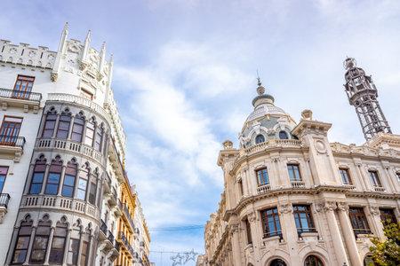 Valencia, Spain - November 24, 2019: Facades of the buildings of the Plaza del Ayuntamiento de Valencia, on a Sunday, with streets cut to traffic. Редакционное