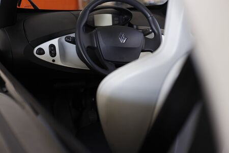 Valencia, Spain - June 25, 2019: Detail of the interior and steering wheel of a Renault car, electric prototype.