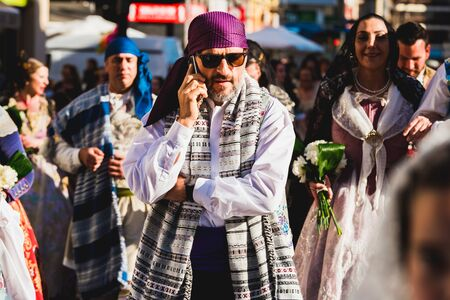 Valencia, Spain - March 17, 2019: Men Falleros dressed in the traditional Valencian costume during the party of Fallas in spring.