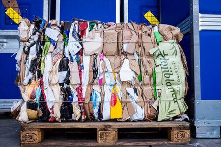 Valencia, Spain - December 4, 2019: Recycled paper bales compacted in a block to send to the industry.