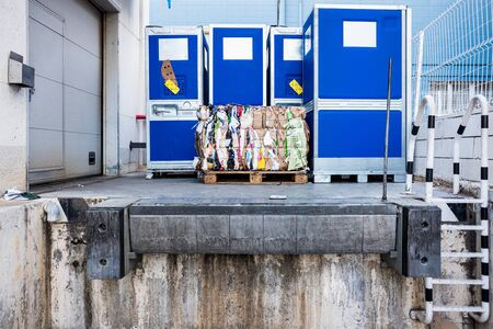 Valencia, Spain - December 4, 2019: A used paper bale on the loading dock of a shop