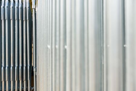 Background with the texture of stainless steel metal bars, industrial elements. 写真素材