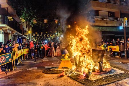 Valencia, Spain - March 19, 2019: Burning of the fallas children of Valencia, the smallest and first sculptures to burn. Редакционное
