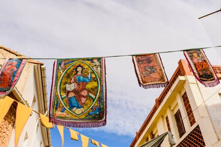 Valencia, Spain - January 27, 2019: Medieval banners hanging between streets at an open-air festival.