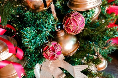 Dolls to decorate at Christmas hanging from the childlike tree. Imagens