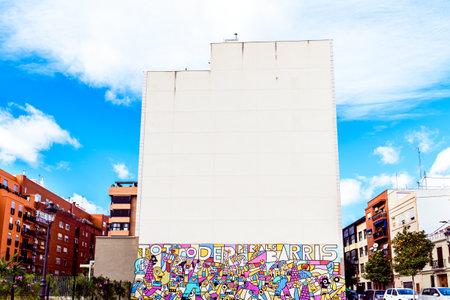 Valencia, Spain - December 25, 2019: Street art mural in the Patraix neighborhood claiming neighborhood rights. Редакционное