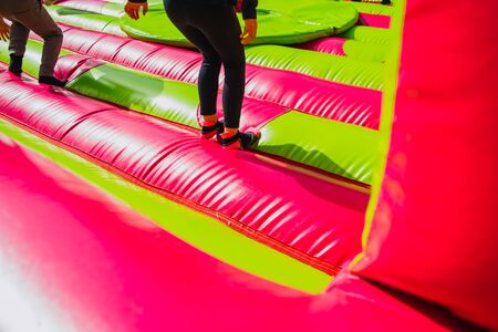 Girl jumping and exercising while having fun in an inflatable castle to bounce.