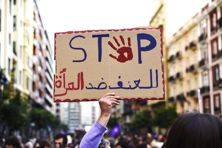 Poster attached by a protester with the word Stop in english and arabic during a demonstration.